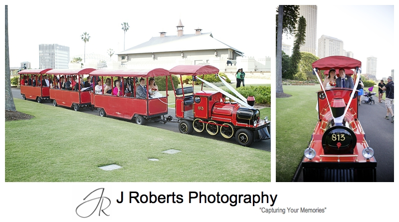 Little red train transporting guests at the royal botanic gardens sydney - sydney wedding photography