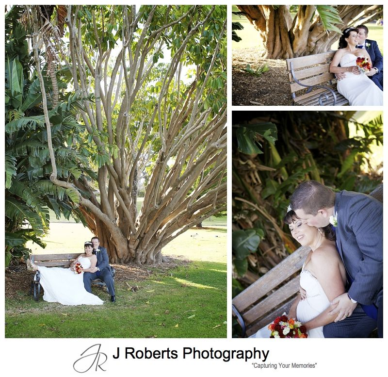 Couple kissing under the trees of the royal botanic gardens sydney - sydney wedding photography
