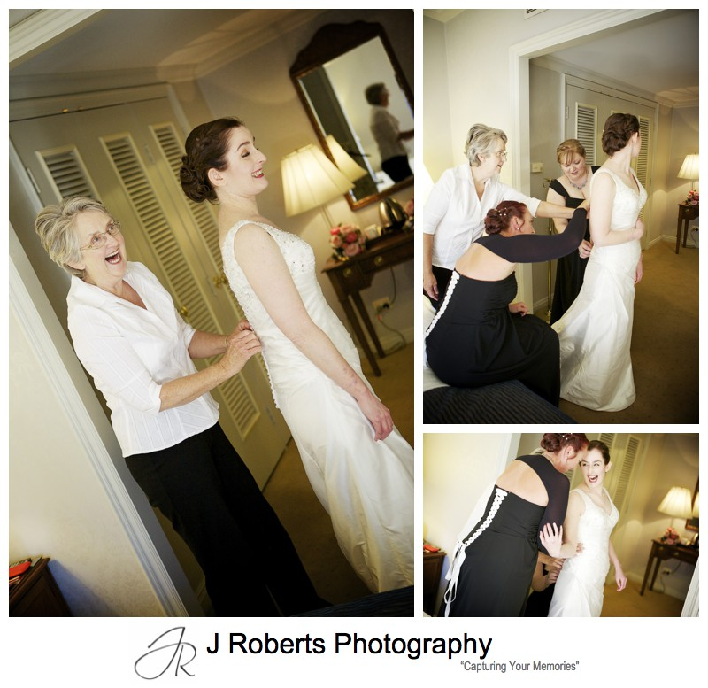 Bride getting dressed with her bridesmaids - sydney wedding photography
