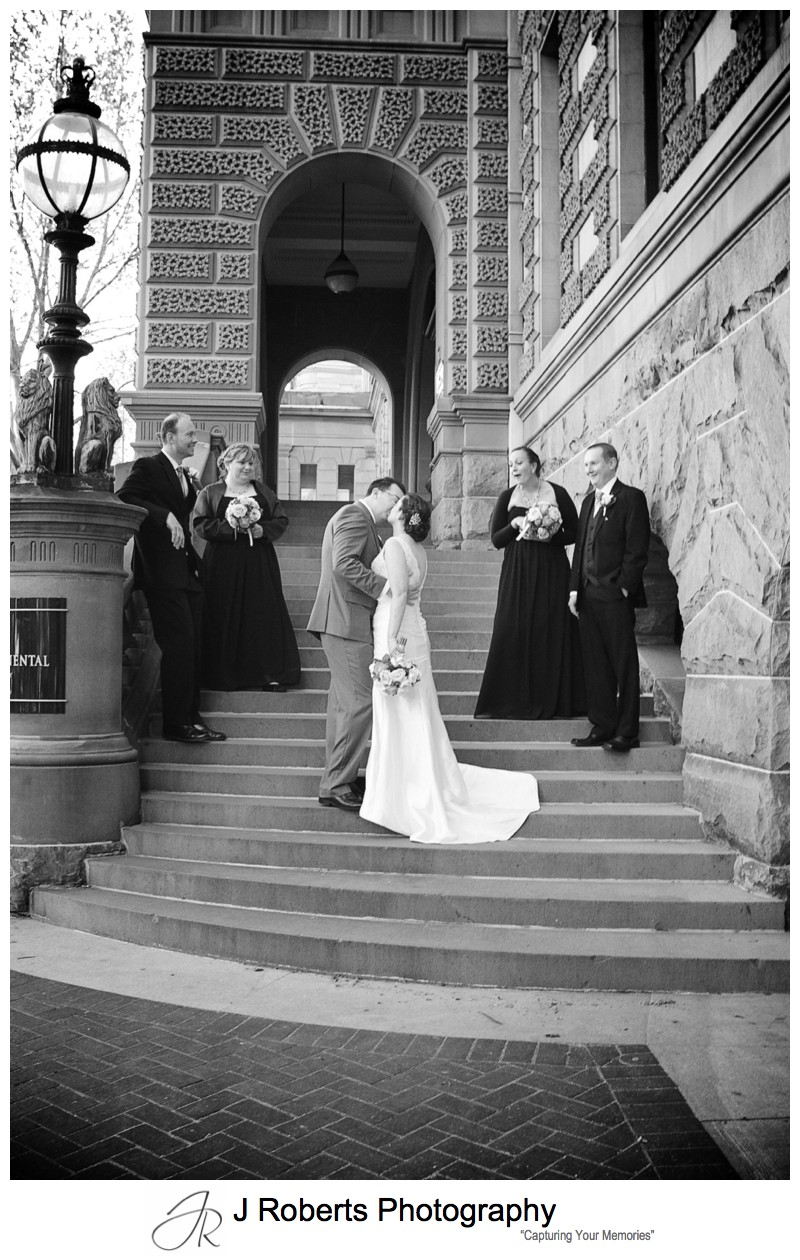 Bridal couple kissing on the steps of the InterContinental Hotel Sydney - sydney wedding photography