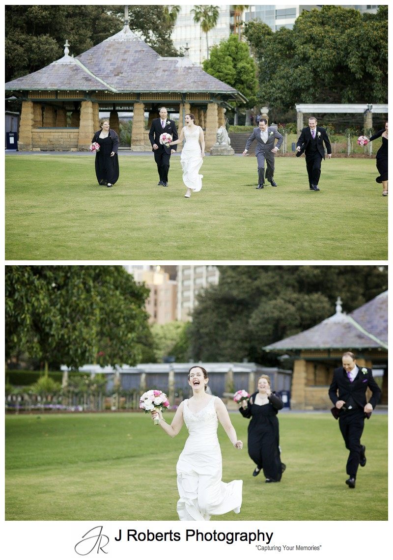 Bride winning a running race with the bridal party - Sydney wedding photography
