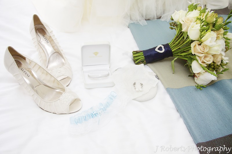 Brides accessories laid out on a bed - wedding photography sydney