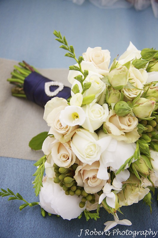 Bridal bouquet with roses and lysianthas - wedding photography sydney