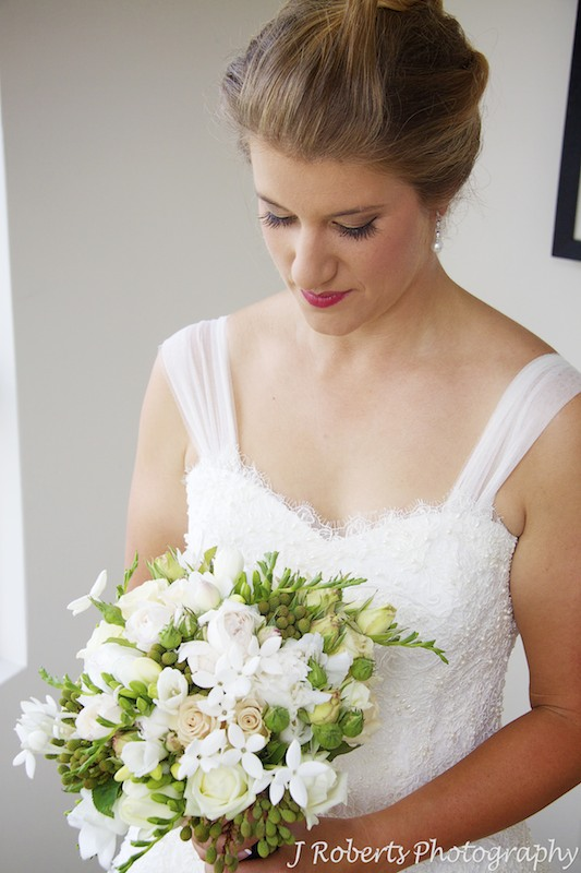 Bride looking down at her bridal bouquet - wedding photography sydney