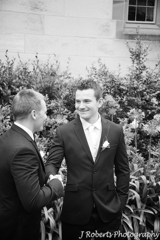 Groom being congratulated by best man - wedding photography sydney