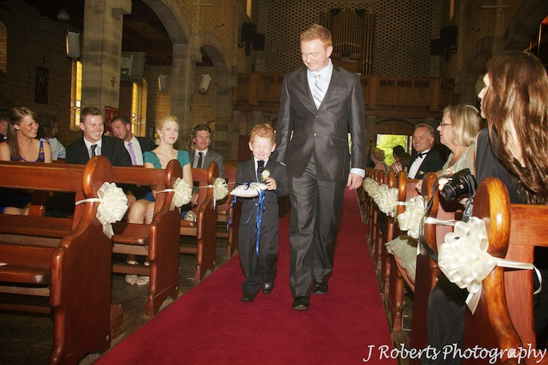 Paige boy being walked down the aisle by his father - wedding photography sydney