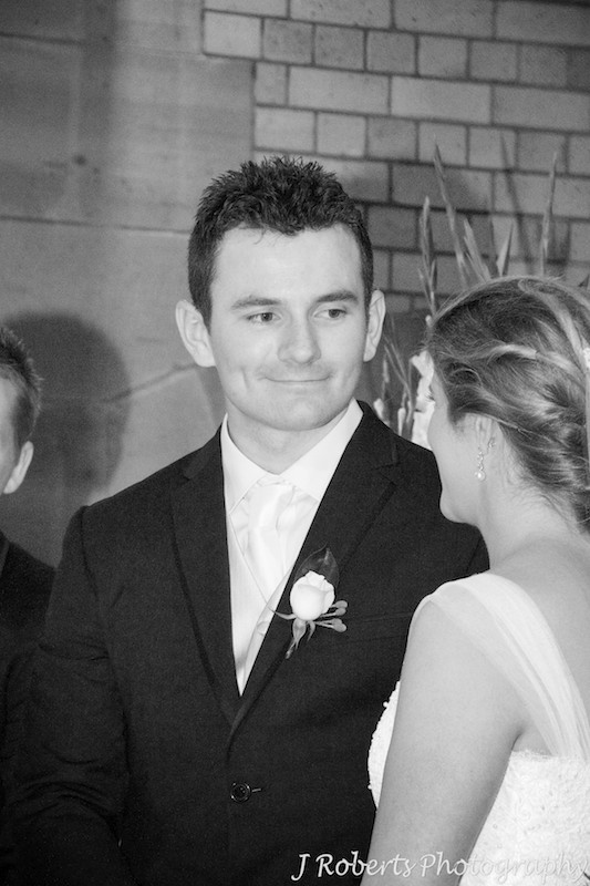 Groom looking at this bride while they say their vows - wedding photography sydney