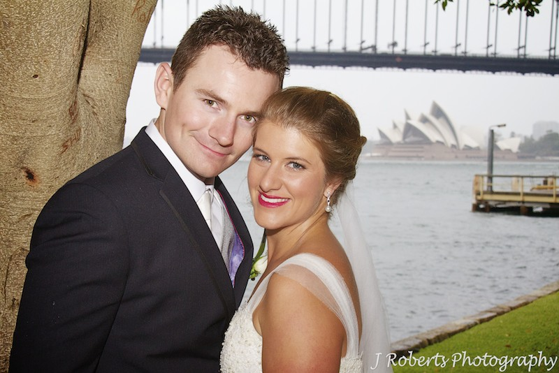 Couple smiling at the camera at Blues Point North Sydney - wedding photography sydney