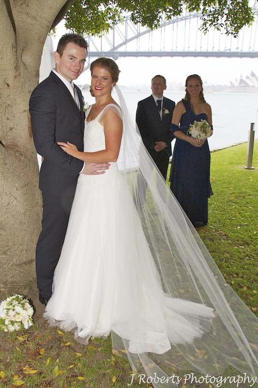 Couple with their attendants and Sydney Harbour Bridge behind - wedding photography sydney