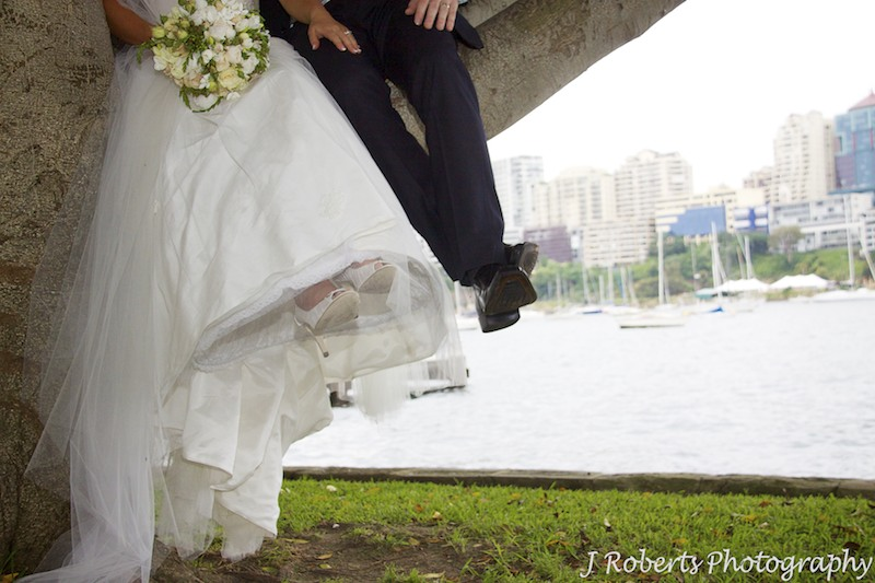 Couples feet swinging in a tree - wedding photography sydney