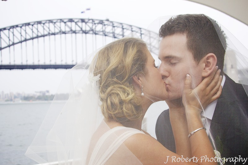 Couple kissing under brides veil - wedding photography sydney