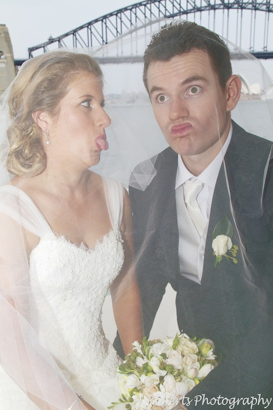 Bridal couple making funny faces - wedding photography sydney