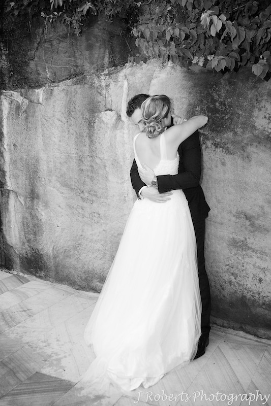 Couple hugging showing the brides back - wedding photography sydney