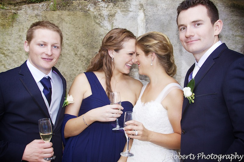 Bride and bridesmaid giggling together - wedding photography sydney