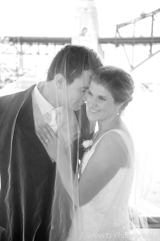 B&W of couple snugging - wedding photography sydney