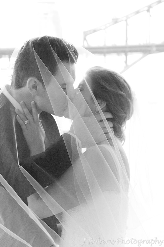 B&W of couple kissing under the veil = wedding photography sydney