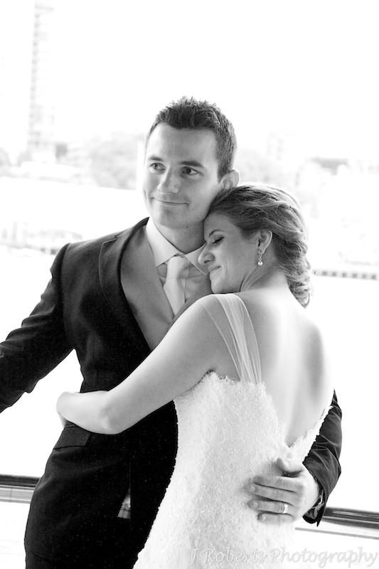 Bride snuggling into groom - wedding photography sydney