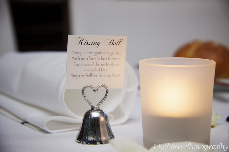 Kissing bell at wedding reception - wedding photography sydney
