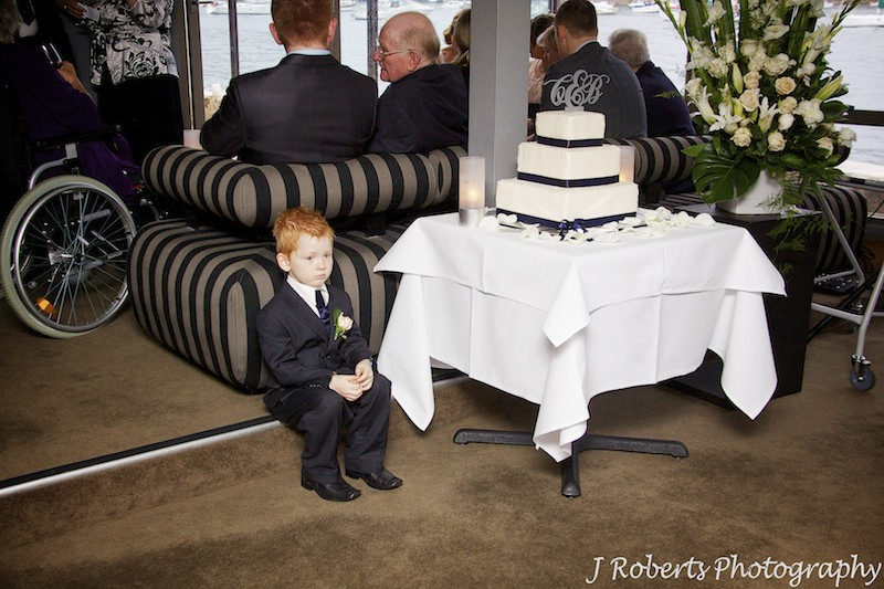 Paige boy sitting next to wedding cake at Sails Lavender Bay - wedding photography sydney