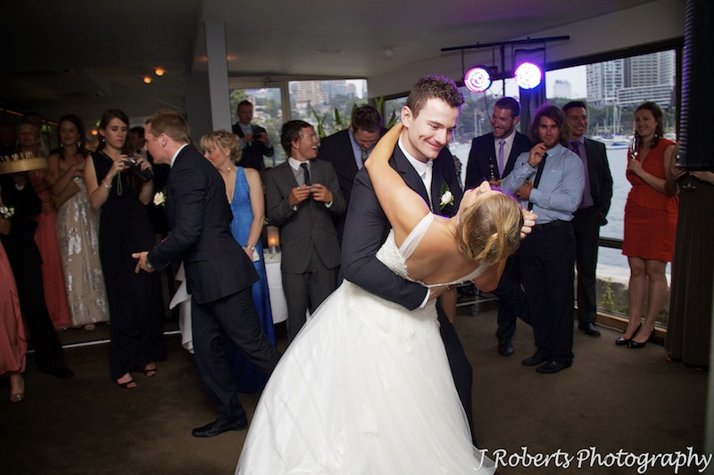 Groom dipping bride during first dance - wedding photography sydney
