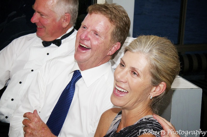Brides parents laughing at wedding speeches - wedding photography sydney