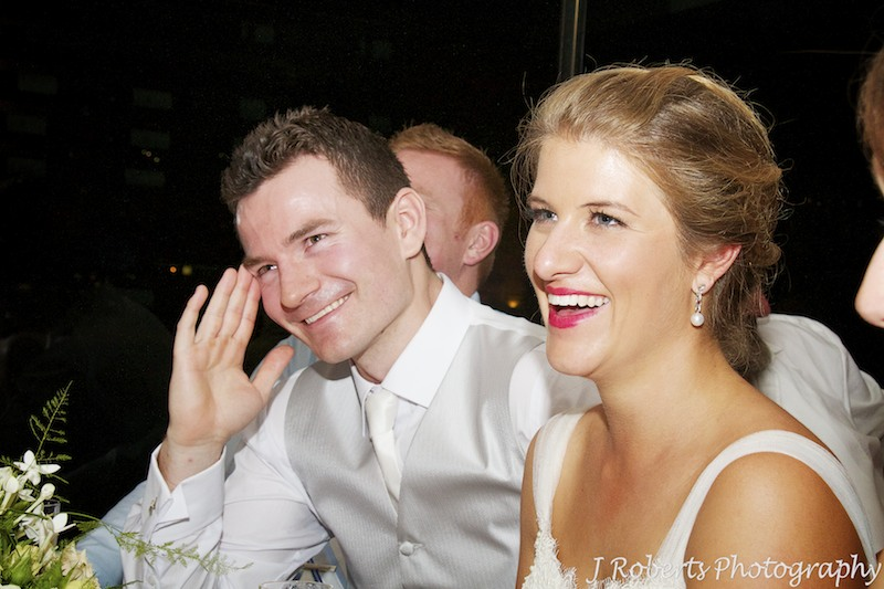 Couple laughing at wedding speeches - wedding photography sydney