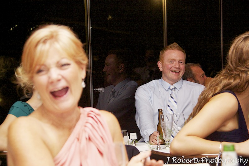 Brother of the groom laughing at wedding speeches - wedding photography sydney