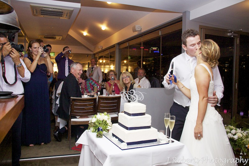 Couple cutting the wedding cake - wedding photography sydney