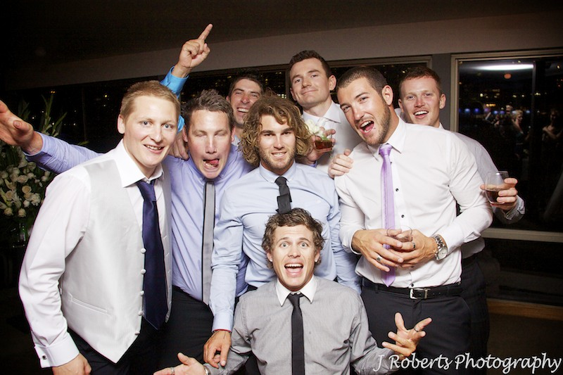 Groom and his mates larking around - wedding photography sydney
