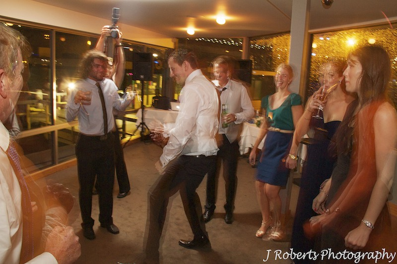 Boogying on the dance floor at wedding reception - wedding photography sydney