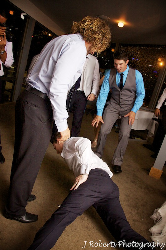 Groom dancing with crowd at wedding reception - wedding photography sydney