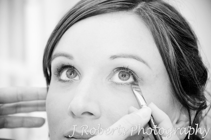 Nervous bride having her make-up applied at home in Roseville - Wedding Photography Sydney