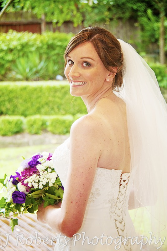 Bride glancing over her shoulder at camera - wedding photography sydney