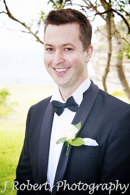 nervous groom smiles before ceremony starts - wedding photography sydney