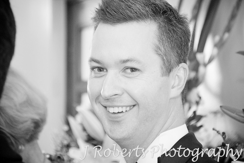 groom all smiles before the ceremony starts - wedding photography sydney