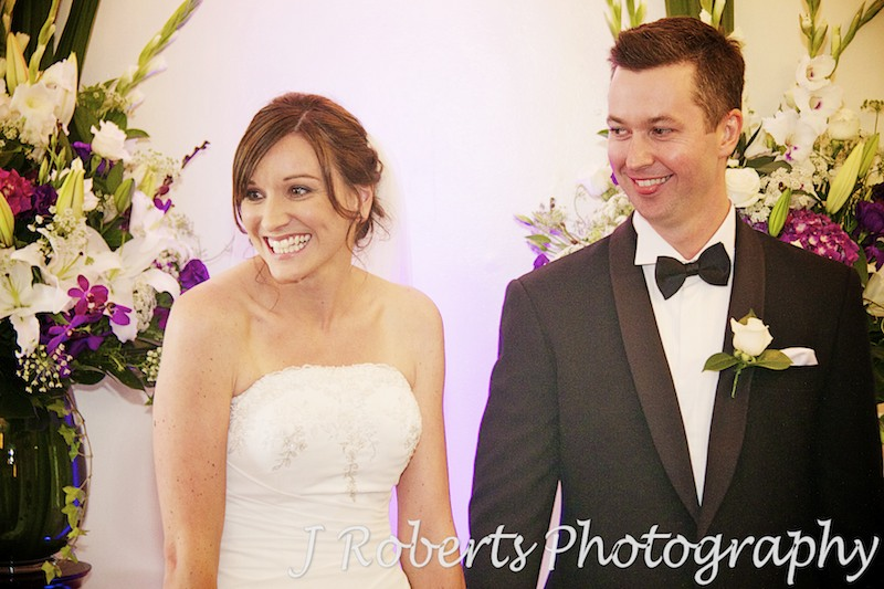 bride and groom laughing with guests during ceremony - wedding ceremony sydney