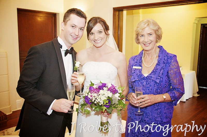 bride and groom with celebrant - wedding photography sydney