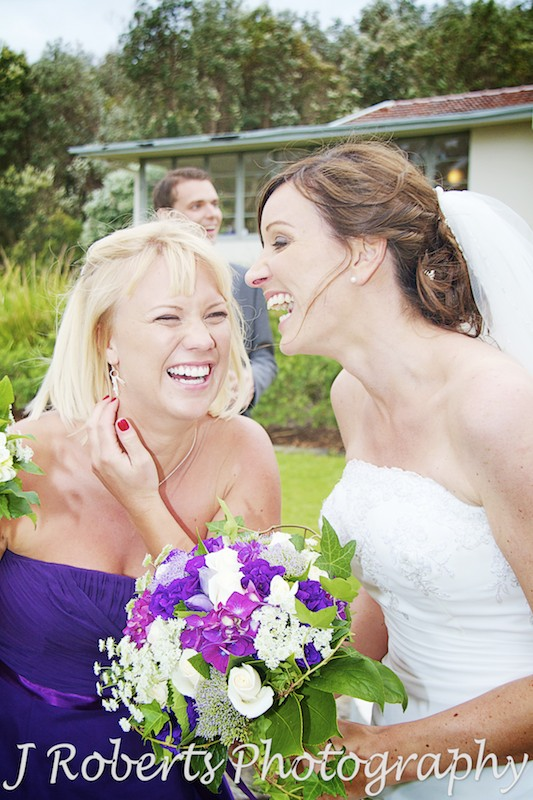 bride and bridesmaid laughing and drinking champagne - wedding photography sydney