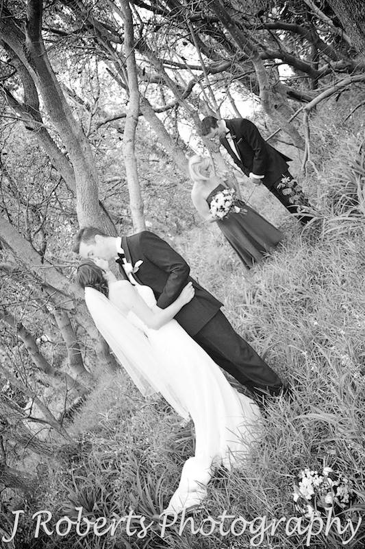 bride and groom kissing in the trees - wedding photography sydney
