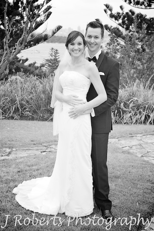 bride and groom embracing on the lawns of the Officers' Mess in Watsons bay - wedding photography sydney