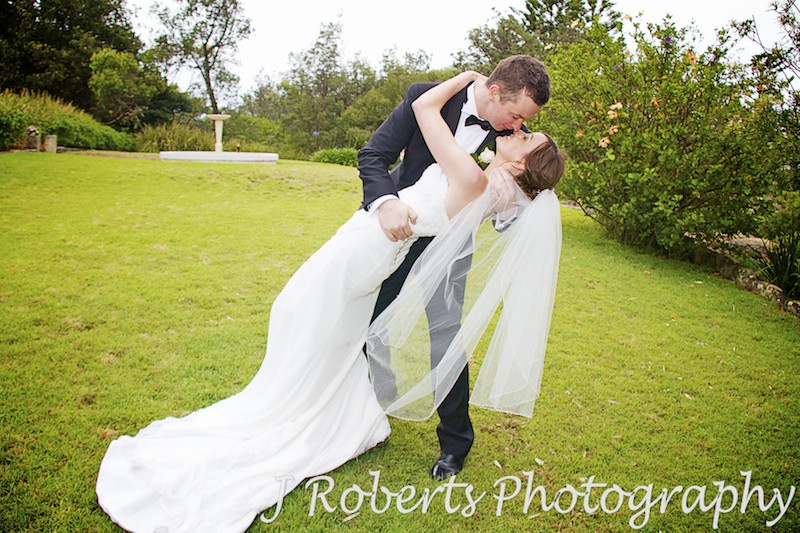 groom gives bride a romantic dip and sexy kiss - wedding photography sydney