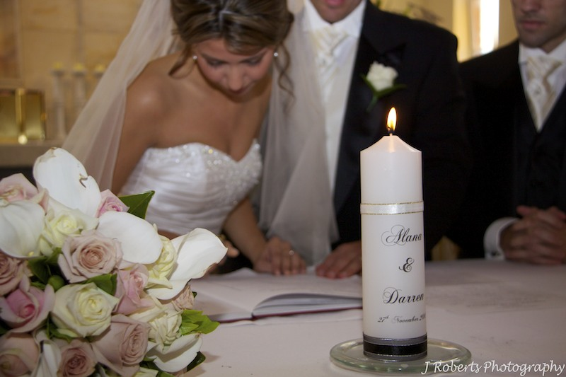 Signing the register - wedding photography