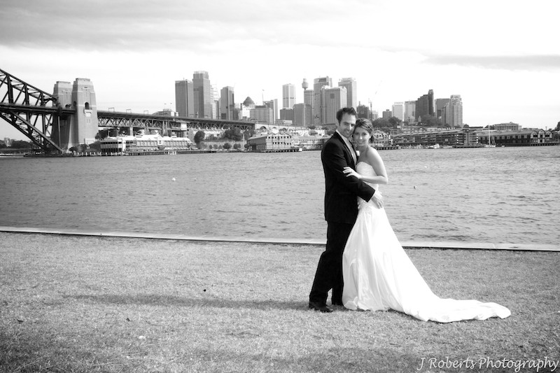 Bride and groom with Sydney harbour in background - wedding photography