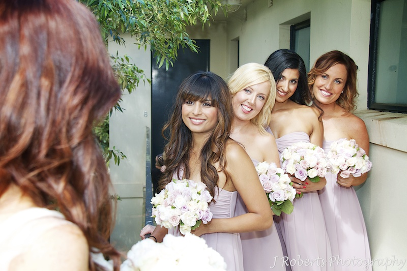 Bridesmaids in soft lilac dresses -wedding photography sydney