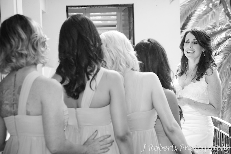 Bride laughing back at her bridesmaids - wedding photography sydney