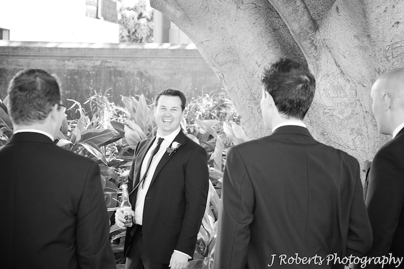 Groom laughing back at his groomsmen - wedding photography sydney