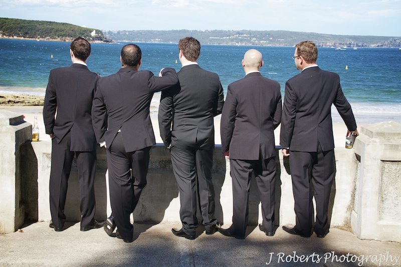 Groom and his groomsmen looking out over Balmoral Beach - wedding photography sydney