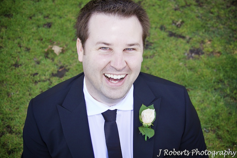 Groom laughing up at the camera - wedding photography sydney