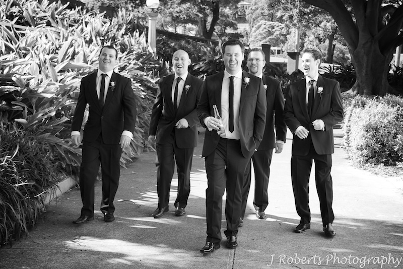 Groom and his groomsman doing the reservoir dogs walk - wedding photography sydney