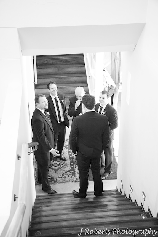 Groom getting a pep talk from his groomsmen pre wedding - wedding photography sydney